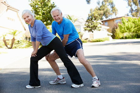 41511814 Elderly Man And Younger Woman Jogging