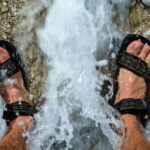water running over feet in sandals