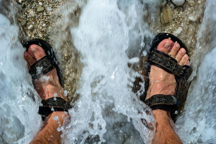 Feet On The Beach In The Waves. Albania
