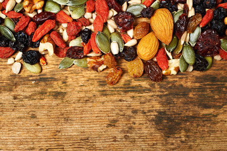 34214207 Mix Nuts Seeds And Dry Fruits, On A Wooden Table