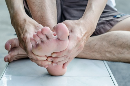 47923217 Man's Hand Being Massaged A Foot