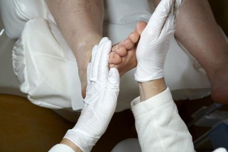 12125372 A Podiatrist Gives A Woman A Leg And Foot Reflexology
