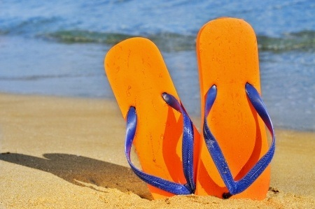 13149442 A Pair Of Flip Flops On The Sand Of A Beach