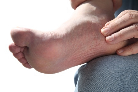 13973747 A Man Tends To His Aching Foot