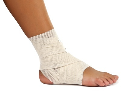 14805063 Injured Ankle With Bandage On A White Background