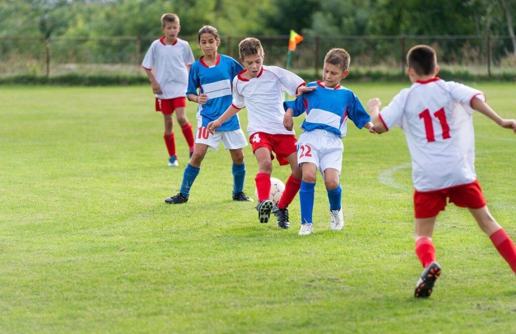 22428788 L Kids Playing Soccer Sports Children Team Ball Field