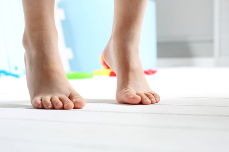 40044901 Childrens Bare Feet. Childs Bare Feet On The Wooden Floor