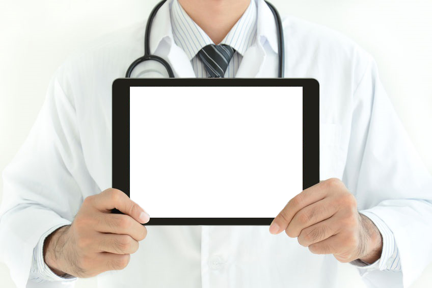 40928820 First Aid Sign On Tablet Pc Screen Held By Doctor