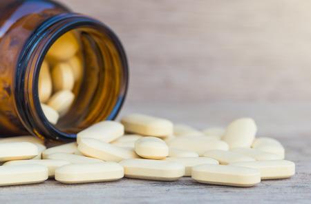 41019359 Pills Or Vitamin In Medicine Bottles On Wood Background