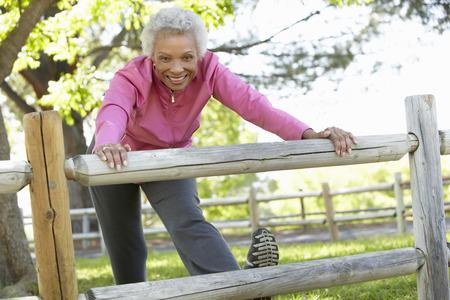 42109761 Senior African American Woman Exercising In Park