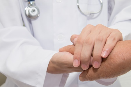 43763052 Doctor Holding An Old Woman's Hand
