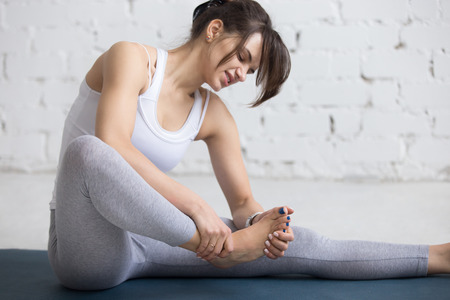 52935337 S Foot Pain Arch Woman Exercising