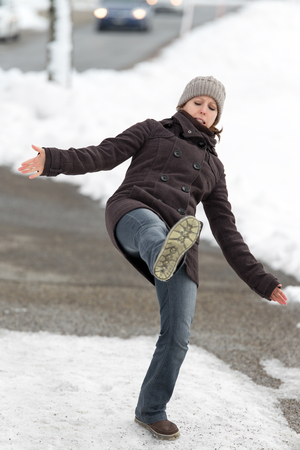 63947547 Young Woman Is Slipping And Falling On Street With Black Ice