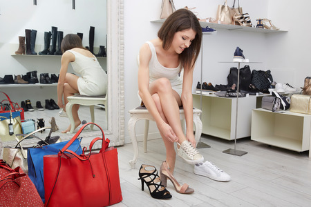 74443358 Female Feet That Is Tried On The Shoes In Shop