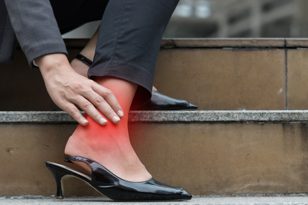 94968129 Business Woman Hurt Ankle Inflammation.