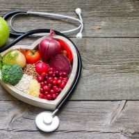 48070183 Healthy Food In Heart And Cholesterol Diet Concept On Vintage Boards